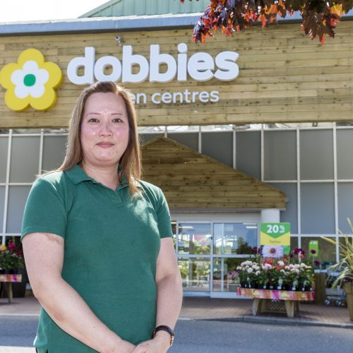 Woman standing outside dobbies